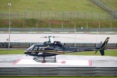 Schwarzer Hubschrauber am Sepang International-Kreisläuf. Lizenzfreie Stockfotos