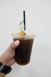 Schwarzer Kaffee des Eises mit Pfirsich Lizenzfreie Stockfotos