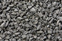 Schwarzer kleiner Felsenhintergrund lizenzfreie stockbilder