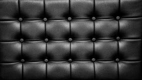 Schwarzer lederner Sofa Surface mit Knöpfen Stockfotos