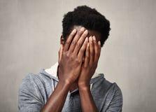 Schwarzer Mann der Krise Stockbild