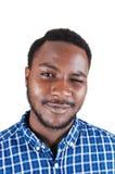 Schwarzer Mann, der mit seinem Auge blinkt. Lizenzfreie Stockfotografie
