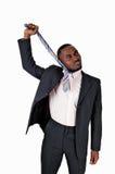 Schwarzer Mann, der seins Bindung zieht. Stockbilder