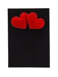 Schwarzer Rahmen des Filzes mit Herzen auf einem weißen Hintergrund Lizenzfreie Stockfotos