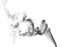 Schwarzer Rauch auf einem weißen Hintergrund Lizenzfreie Stockfotografie