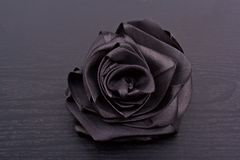 Schwarzer Satin Rose Stockfoto