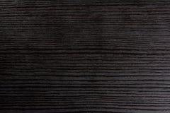 Schwarzer Schreibtisch strahlt Arbeitsplatz-Hintergrund-hölzernen Beschaffenheits-Blitz an Stockfotografie