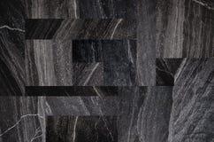 Schwarzer Steinbeschaffenheits-Hintergrund, nahtloser Stein deckt Beschaffenheit mit Ziegeln Stockfoto