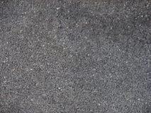 Schwarzer Steinwandhintergrund Stockfotografie