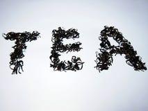 Schwarzer Tee machen ein Teewort Lizenzfreie Stockbilder