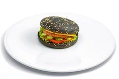 Schwarzer Teig des Cheeseburgers Stockbild
