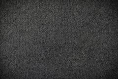Schwarzer Teppich oder schwarzer Beschaffenheitshintergrund des woolen Gewebes lizenzfreie stockbilder