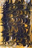 Schwarzer und ockerhaltiger Hintergrund Lizenzfreie Stockbilder