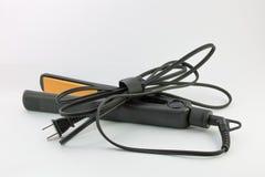 Schwarzer und orange Haarstrecker Lizenzfreies Stockfoto
