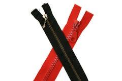 Schwarzer und roter Reißverschluss Stockfoto