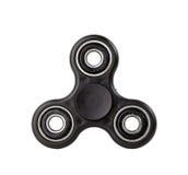 Schwarzer Unruhe-Spinner auf weißem Hintergrund lizenzfreies stockfoto