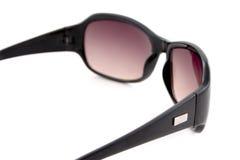 Schwarzes abgetönte Sonnenbrillen Stockbild