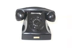 Schwarzes antikes Telefon Stockfotos