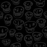 Schwarzes auf schwarzem Schädel-Muster Stockfotografie