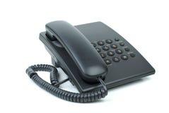 Schwarzes Bürotelefon mit dem Hörer bei aufliegendem Hörer Lizenzfreie Stockbilder