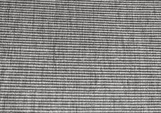Schwarzes Baumwollgewebe mit Streifen-Muster-Hintergrund Stockbild