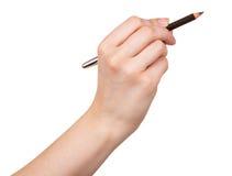 Schwarzes Bleistiftmake-up in der weiblichen Hand lokalisiert auf weißem Hintergrund Stockfoto