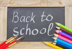 Schwarzes Brett mit zurück zu Schule Stockbilder
