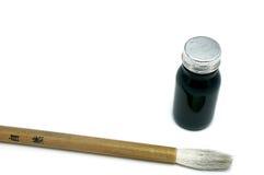 Schwarzes Kandschi mit einer Kalligraphiebürste Lizenzfreies Stockbild