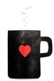 Schwarzes Cup mit Inneres herausgeschnittenem Papier Lizenzfreies Stockbild