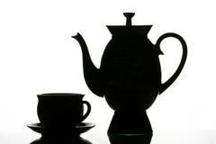 Schwarzes Cup und Teekanne stockfotos