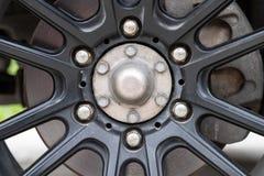 Schwarzes der alten Eisenrad-Mag-, rostigen, schmutzigen und altenzustandes Lizenzfreie Stockfotos