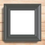 Schwarzes Fotofeld auf hölzernem Hintergrund Stockbilder