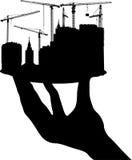 Schwarzes Gebäude auf Platte in der menschlichen Hand stock abbildung