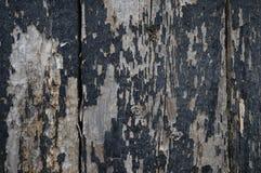 Schwarzes gemaltes Retro- schauendes hölzernes Brett der Weinlese stockfotos