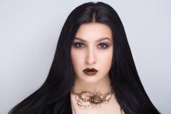 Schwarzes Haar der Frau stockbild