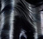 Schwarzes Haar-Hintergrund Lizenzfreie Stockfotografie