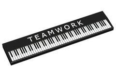Schwarzes Klavier mit Wortteamwork Lizenzfreie Stockfotografie