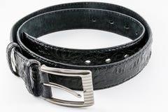 Schwarzes Krokodil-strukturierter Ledergürtel Stockfoto