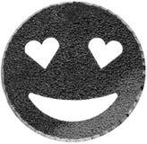 schwarzes lächelndes Gesicht, das mit Herz-förmigen Augen glänzt Stockbild