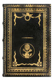 Schwarzes ledernes Buch mit Goldrahmen Stockbild