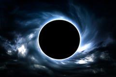 Schwarzes Loch in den Wolken stockbild