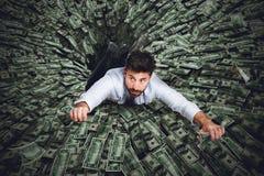 Schwarzes Loch des Geldes Lizenzfreie Stockfotos