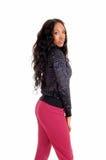 Schwarzes Mädchen in den rosa Strumpfhosen im Profil Lizenzfreie Stockfotos