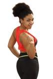 Schwarzes Mädchen misst eine Taille Stockfoto