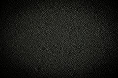Schwarzes Materialhintergrund vigniette Stockbild