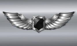 Schwarzes Metallgeflügeltes Schildemblem Stockfoto