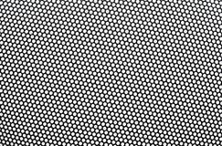 Schwarzes Metallgitter mit runden Blendenöffnungen. Stockfotos