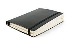 Schwarzes moleskine lizenzfreies stockbild