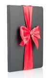 Schwarzes Notizbuch mit rotem Farbband Stockbilder