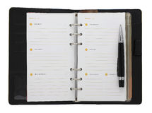 Schwarzes Notizbuch und eine Feder Stockbilder